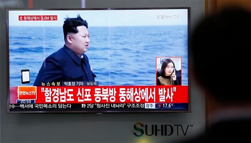 A man watches a TV news program showing a file footage of North Korean leader Kim Jong Un at the Seoul Train Station in Seoul, South Korea, Saturday, April 23, 2016.