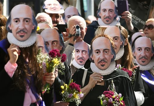Members of the public wear William Shakespeare masks during a parade marking 400-years since the death of the playwright in Stratford-upon-Avon, England, Saturday April 23, 2016.