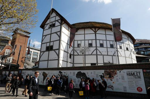 A view of The Globe Theatre, nestled alongside contemporary buildings on the banks of the River Thames in London, in this photo dated Tuesday, April 19, 2016.
