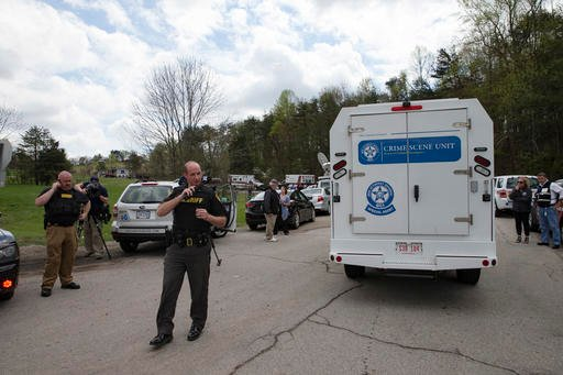 Authorities allow crime scene investigation vehicles to pass a perimeter checkpoint near a crime scene, Friday, April 22, 2016, in Pike County, Ohio.