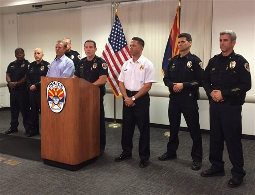 Chandler Police Chief Sean Duggan speaks on the shooting of two officers at a news conference at police headquarters in Chandler, Ariz., on Saturday, April 23, 2016.