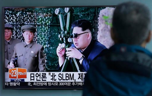 A South Korean man watches a TV news program showing an image published Sunday in North Korea's Rodong Sinmun newspaper of North Korean leader Kim Jong Un at Seoul Railway station in Seoul, South Korea, Sunday, April 24, 2016. North Korea said Sunday that