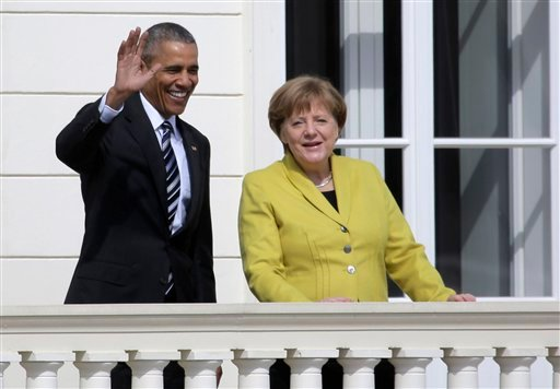 German Chancellor Angela Merkel, right, welcomes U.S. President Barack Obama at Herrenhausen Palace in Hannover, northern Germany, Sunday, April 24, 2016. Obama is on a two-day official visit to Germany. (AP Photo/Markus Schreiber)