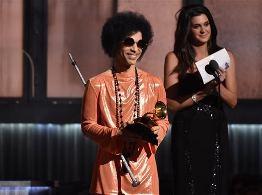In this Feb. 8, 2015, file photo, Prince presents the award for album of the year at the 57th annual Grammy Awards in Los Angeles. Beyond dance parties and hit songs, Prince's legacy included black activism. He said black lives matter before presenting a