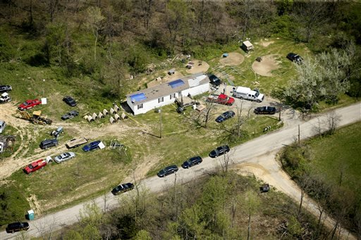 This aerial photo shows one of the locations being investigated in Pike County, Ohio, as part of an ongoing homicide investigation, Friday, April 22, 2016. Several people were found dead Friday at multiple crime scenes in rural Ohio, and at least most of