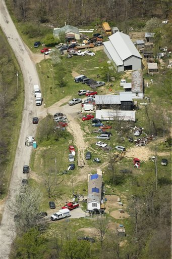This aerial photo shows two of the locations being investigated in Pike County, Ohio, as part of an ongoing homicide investigation, Friday, April 22, 2016. Several people were found dead Friday at multiple crime scenes in rural Ohio, and at least most of