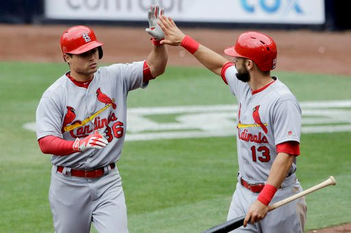 St. Louis Cardinals' Aledmys Diaz, left is greeted by teammate Matt Carpenter (13) after hitting a home run during the sixth inning of a baseball game against the San Diego Padres Sunday, April 24, 2016, in San Diego. (AP Photo/Gregory Bull)