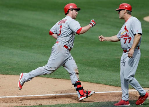 St. Louis Cardinals' Jedd Gyorko, left, is greeted by third base coach Chris Maloney (77) after hitting a home run during the sixth inning of a baseball game against the San Diego Padres, Sunday, April 24, 2016, in San Diego. (AP Photo/Gregory Bull)