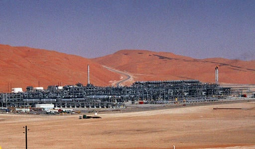 "In this Monday, March 8, 2004 file photo, an industrial plant strips natural gas from freshly pumped crude oil is seen at Saudi Aramco's Shaybah oil field at Shaybah in Saudi Arabia's Rub al-Khali desert. King Salman announced the approval for the ""Vision"