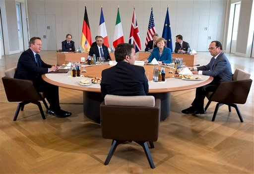 From left, British Prime Minister David Cameron, U.S. President Barack Obama, Italian Prime Minister Matteo Renzi, German Chancellor Angela Merkel, and French President Francois Hollande, meet at Schloss Herrenhausen in Hannover, Germany, Monday, April 25