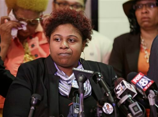 In this March 3, 2015, file photo, Samaria Rice, the mother of Tamir Rice, a boy fatally shot by a Cleveland police officer, talks about the family's lawsuit against the city in Cleveland. The city of Cleveland has reached a settlement Monday, April 25, 2