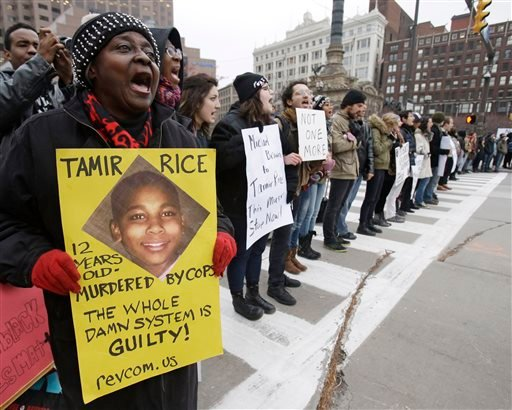In this Nov. 25, 2014, file photo, demonstrators block Public Square in Cleveland, during a protest over the police shooting of Tamir Rice. The city of Cleveland has reached a settlement Monday, April 25, 2016, in a lawsuit over the death of Rice, a black