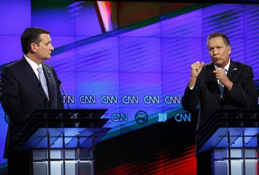 In this March 10, 2016, file photo, Republican presidential candidate Ohio Gov. John Kasich, right, speaks as Republican presidential candidate, Sen. Ted Cruz, R-Texas, listens, during a Republican presidential debate.