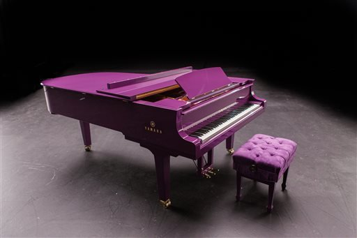 This undated photo released by Yamaha Entertainment Group shows a custom-made purple piano the company manufactured for musician Prince.