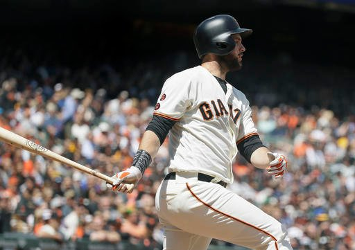 San Francisco Giants' Brandon Belt hits a two RBI triple against the San Diego Padres in the fourth inning of their baseball game Wednesday, April 27, 2016, in San Francisco. (AP Photo/Eric Risberg)
