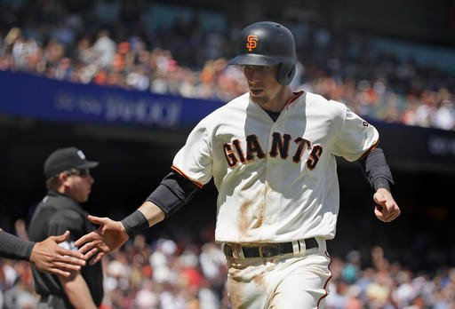 San Francisco Giants' Matt Duffy is greeted near home plate after scoring the Giants' eighth run in the fourth inning of their baseball game against the San Diego Padres Wednesday, April 27, 2016, in San Francisco. (AP Photo/Eric Risberg)