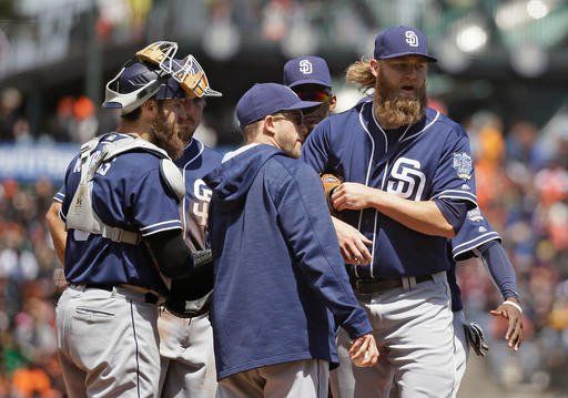San Diego Padres starting pitcher Andrew Cashner, right, heads for the dugout after being removed by manager Andy Green, center, in the third inning of their baseball game against the San Francisco Giants Wednesday, April 27, 2016, in San Francisco. At le