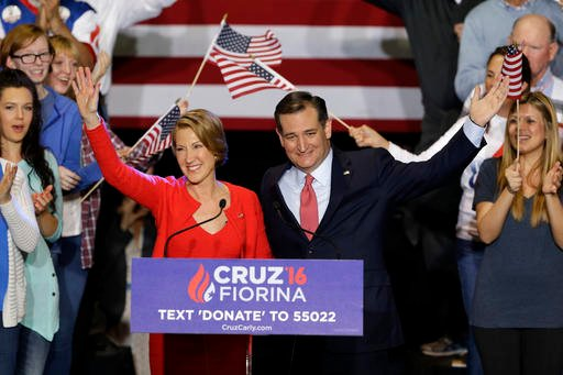Republican presidential candidate Sen. Ted Cruz, R-Texas, joined by former Hewlett-Packard CEO Carly Fiorina waves during a rally in Indianapolis, Wednesday, April 27, 2016.