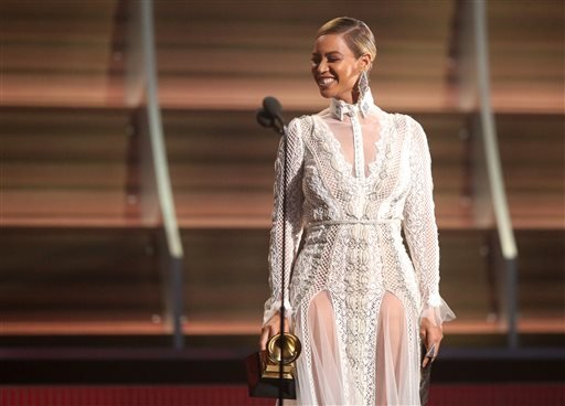 In this Feb. 15, 2016, file photo, Beyoncé presents the award for record of the year at the 58th annual Grammy Awards in Los Angeles.
