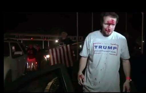 This still image taken from video shows a supporter of Republican presidential candidate Donald Trump after a protest on Thursday, April 28, 2016 in Costa Mesa, Calif.