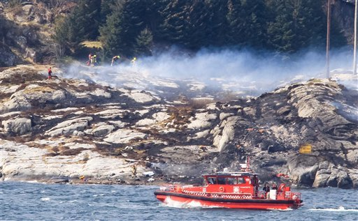 A search and rescue vessel patrols off the island of Turoey, near Bergen, Norway, as emergency workers attend the scene of a helicopter crash believed to have 13 people aboard, Friday April 29, 2016.