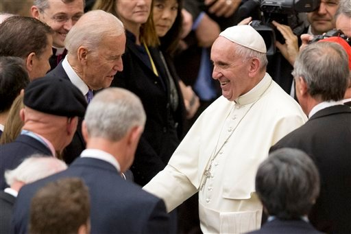 Pope Francis shakes hands with US vice president Joe Biden as he takes part at a congress on the progress of regenerative medicine and its cultural impact, being held in the Pope Paul VI hall at the Vatican, Friday, April 29, 2016.