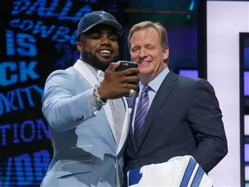Ohio State's Ezekiel Elliott takes a selfie with NFL commissioner Roger Goodell after being selected by Dallas Cowboys as the fourth pick in the first round of the 2016 NFL football draft, Thursday, April 28, 2016, in Chicago.