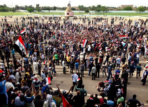 Supporters of Shiite cleric Muqtada al-Sadr attend a sit-in inside Baghdad's highly fortified Green Zone, Sunday, May 1, 2016. Anti-government protesters tore down walls and poured into the Iraqi capital's heavily fortified Green Zone yesterday, where the