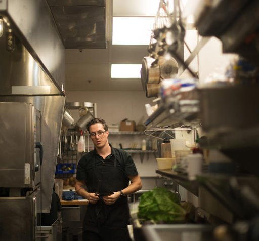 In this April 30, 2016 photo, chef Ray Roberts, who runs multiple Peoples Organic restaurants with his wife in the Twin Cities, prepares meals at his Edina, Minn., location. Roberts was the personal chef for music megastar Prince until he was found dead o