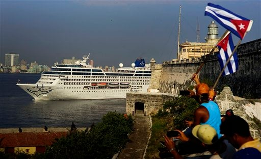 People waving Cuban flags greet passengers on Carnival's Adonia cruise ship as they arrive from Miami in Havana, Cuba May 2, 2016. (AP Photo/Ramon Espinosa)