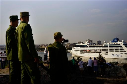 Cuban soldiers watch the Carnival Adonia cruise ship arrive from Miami, in Havana, Cuba, Monday, May 2, 2016. (AP Photo/Ramon Espinosa)