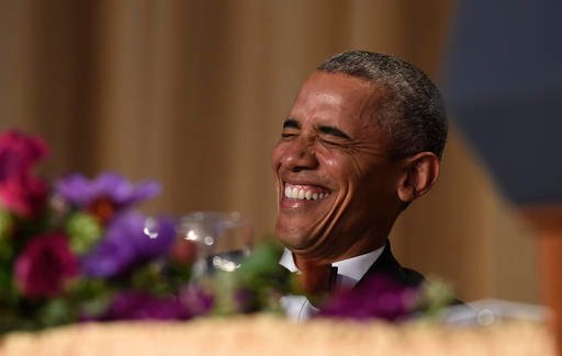President Barack Obama laughs as he listens to Larry Wilmore, the guest host from Comedy Central, speak at the annual White House Correspondents' Association dinner at the Washington Hilton in Washington, Saturday, April 30, 2016.
