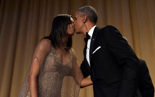 President Barack Obama, right, kisses first lady Michelle Obama, left, after he spoke at the annual White House Correspondents' Association dinner at the Washington Hilton in Washington, Saturday, April 30, 2016.