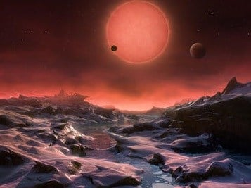 The artist's impression provided by European Southern Observatory on May 2, 2016 shows an imagined view from the surface one of the three planets orbiting an ultracool dwarf star just 40 light-years from earth that were discovered using the TRAPPIST teles