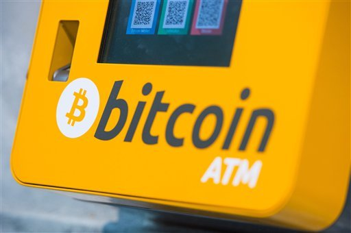 File - This is a Oct. 16, 2015 file photo of a Bitcoin ATM. An Australian man long thought to be associated with the digital currency Bitcoin has publicly identified himself as its creator. BBC News said Monday, May 2, 2016 that Craig Wright told the medi