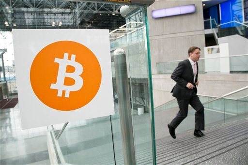 In this April 7, 2014 file photo, a man arrives for the Inside Bitcoins conference and trade show in New York. An Australian man long thought to be associated with the digital currency Bitcoin has publicly identified himself as its creator. BBC News said