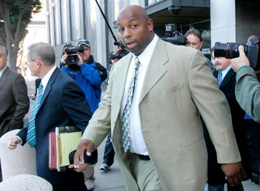 In this Jan. 18, 2008 file photo, former NFL football player Dana Stubblefield leaves a federal courthouse in San Francisco.