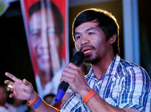 Boxing star Manny Pacquiao addresses supporters as he campaigns for a seat in the Philippine Senate, on Thursday, April 28, 2016 at San Pablo city, Laguna province south of Manila, Philippines.