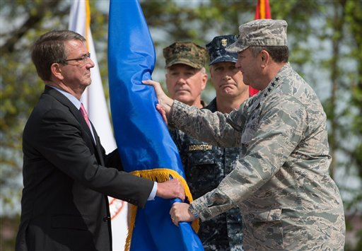 US Secretary of Defense Ashton Carter, left, receives the rank pennant from US Air Force General Philip Breedlove, the outgoing commanding officer of US and NATO troops in Europe, during the change in command at the United States European Command (EUCOM),