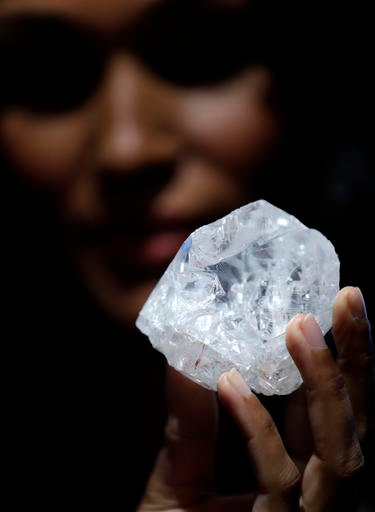 A model displays a large diamond at Sotheby's in New York, Wednesday, May 4, 2016.