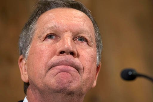 Republican presidential candidate Ohio Gov. John Kasich pauses as he speaks at The Franklin Park Conservatory & Botanical Gardens, Wednesday, May 4, 2016, in Columbus. Ohio. Kasich announced the end of his White House bid. (AP Photo/John Minchillo)