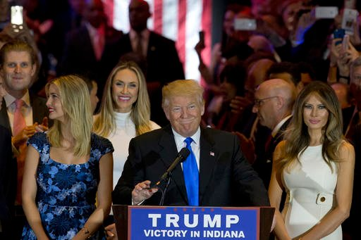 Republican presidential candidate Donald Trump is joined by his wife Melania, right, and daughter Ivanka, left, as he arrives for a primary night news conference, Tuesday, May 3, 2016, in New York. (AP Photo/Mary Altaffer)