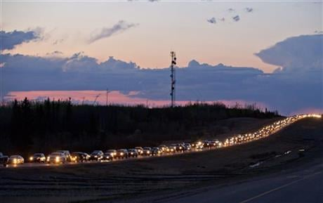 Traffic lines the highway as residents leave Fort McMurray, Alberta, Canada, on Tuesday May 3, 2016. More than 80,000 residents were ordered to flee as a wildfire moved into the city, destroying whole neighborhoods. (Jason Franson/The Canadian Press via A