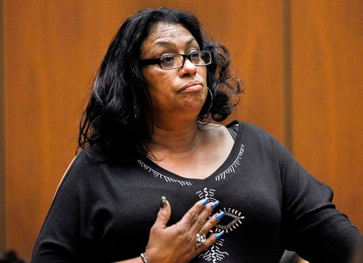 """In this Feb. 6, 2015 file photo, Enietra Washington pauses to compose her thoughts as she notices serial killer suspect Lonnie Franklin Jr., during a preliminary hearing in Los Angeles Superior Court. Washington is the sole known survivor in 10 """"Grim Slee"""