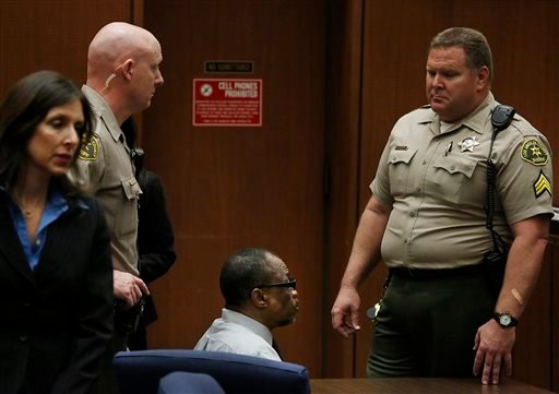 """Lonnie Franklin Jr., center, sits in count in Los Angeles, Thursday, May 5, 2016. The former trash collector in Los Angeles was convicted Thursday of 10 """"Grim Sleeper"""" serial killings that spanned two decades and targeted vulnerable young black women in t"""