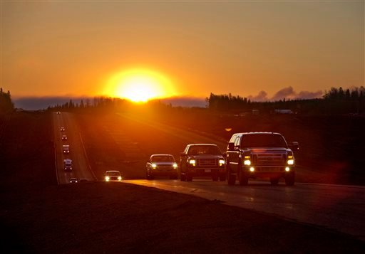 Evacuees leave Fort McMurray in the early morning, after being stranded north of wildfire in Fort McMurray, Alberta, Canada on Friday, May 6, 2016.