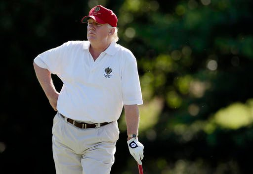 In this June 27, 2012, file photo, Donald Trump stands on the 14th fairway during a pro-am round of the AT&T National golf tournament at Congressional Country Club in Bethesda, Md.
