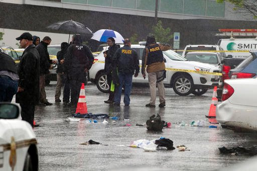 Montgomery County, Md. Police officers investigate the scene after a shooting outside the Westfield Montgomery Mall in Bethesda, Md., Friday, May 6, 2016.