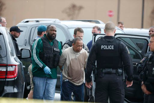 Police take Eulalio Tordil, 62, a suspect in three fatal shootings in the Washington, D.C., area into custody in Bethesda, Md. May 6, 2016. (AP Photo/Alex Brandon)