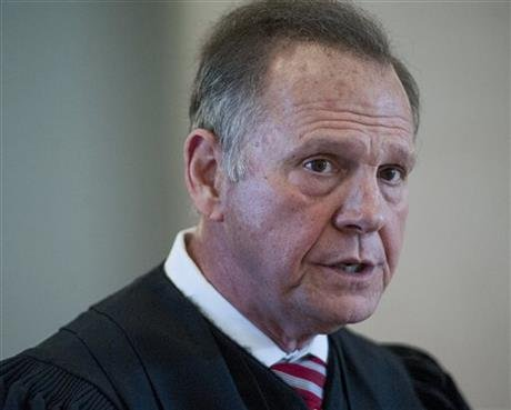 Moore says a judicial ethics panel should dismiss complaints filed against him as he fought to keep gays and lesbians from marrying in the state. (Mickey Welsh/Montgomery Advertiser via AP)